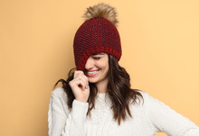 Shy Woman Smiling And Pulling Hat Down