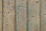 Old metal fence with brown peeling paint. Abstract background