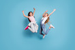Leinwanddruck Bild - Full length body size view of two people nice-looking crazy lovely attractive cheerful carefree straight-haired pre-teen girls having fun great weekend time overjoy isolated over blue pastel