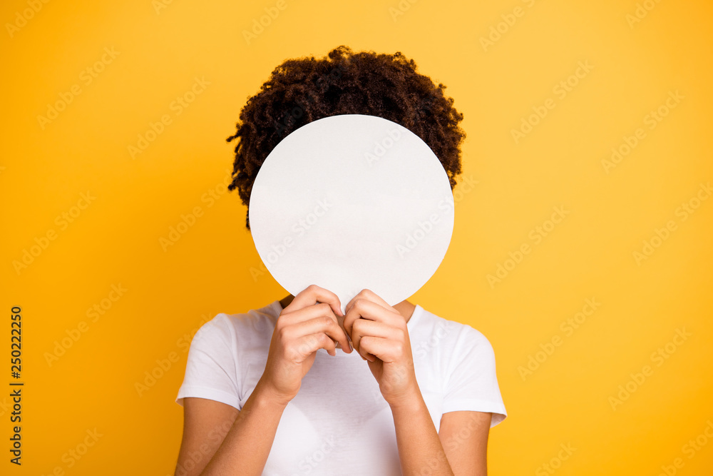 Fototapeta Close up photo beautiful amazing she her dark skin lady hiding face round circle banner placard do not want be recognized wear casual white t-shirt isolated yellow bright vibrant vivid background
