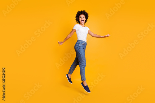 Fototapety, obrazy: Full length body size side profile photo jumping high beautiful she her lady yelling rushing shopping low prices amazed wearing casual jeans denim white t-shirt clothes isolated yellow background