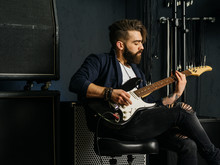 Bearded Man Playing Guitar In ...