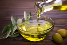 Bowl With Olive Oil On Wooden Table
