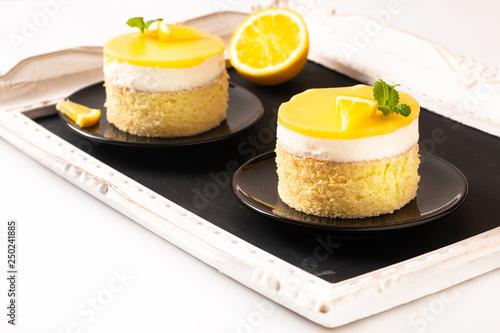 Wallpaper Mural Food concept Homemade Lemon curd sponge cake with fresh whipped cream in black p