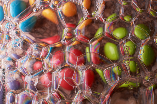 Fotobehang Macrofotografie abstract background of colored drops bubbles on the water