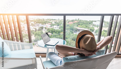 life-work balance, relaxation healthy quality living lifestyle in summer holiday vacation of freelancer woman take it easy resting in resort hotel balcony having peace of mind