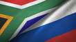 canvas print picture - South Africa and Russia two flags textile cloth, fabric texture