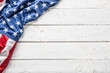 canvas print picture Top of view American flag on white wooden table