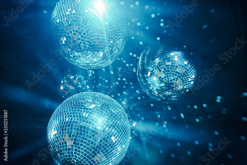 classic blue shining disco balls. disco atmosphere concept. color of the year 2020 - 250251887