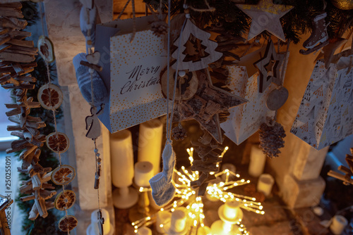 Fototapety, obrazy: New Year's background. Toys are New Year's, sparks, dried oranges, candles on a fireplace