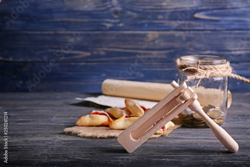 Composition with gragger and hamantaschen for Purim holiday on wooden table Canvas Print