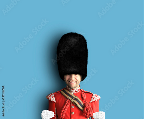Photo Young man in the costume of the Royal guards of Britain