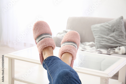 Stampa su Tela  Young woman in slippers resting at home