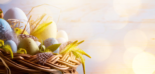 sunny Easter background with Easter eggs in the basket