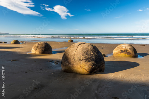 Landmark on the east coast of the South Island, Moeraki Boulders under a dramatic dawn sky Wallpaper Mural
