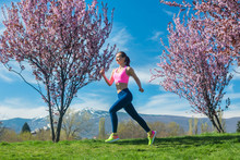 Woman Running For Fitness On A Spring Day