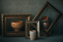 Side View Ceramic Cups  And Bowls In Picture Frames Like On Painting
