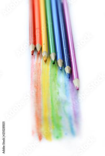 Fotografía  Colored watercolor pencils paint a rainbow. Creation