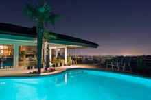 Illuminated Pool At Night With City In Background, Los Angeles, California, United States