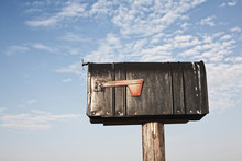Mailbox On A Wooden Post
