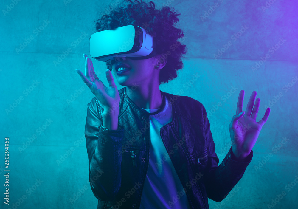 Fototapety, obrazy: Contemporary woman in VR headset in neon light