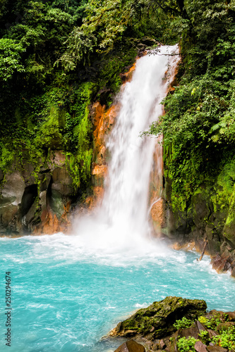 Beautiful waterfall in northern Costa Rica inside the Tenorio National Park with a bright turquoise color in the water Wall mural