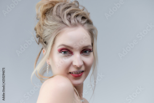 Poster womenART Smiling girl with clean skin, natural make-up and white teeth on a gray background in a beauty salon