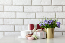 Gift Boxes And Flowers On White Wall Background