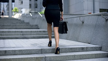 Businesswoman Coming Upstairs To Office Center, Going To Work, Busy Lifestyle