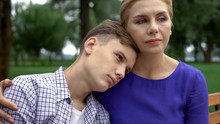 Caring Mother Supporting Teen ...