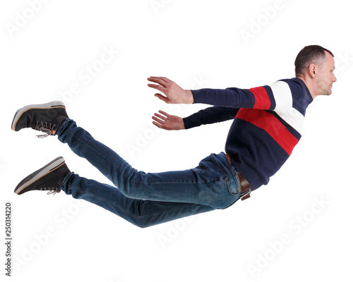 Fotografia, Obraz Side view of man in zero gravity or a fall.
