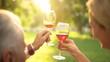 Leinwandbild Motiv Senior couple holding wineglasses and drinking alcohol beverage on outdoor date