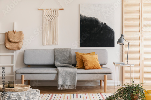 Abstract black and white painting and handmade macrame on white wall of natural Fototapete