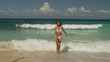 WS Young woman walking on beach / Seychelles