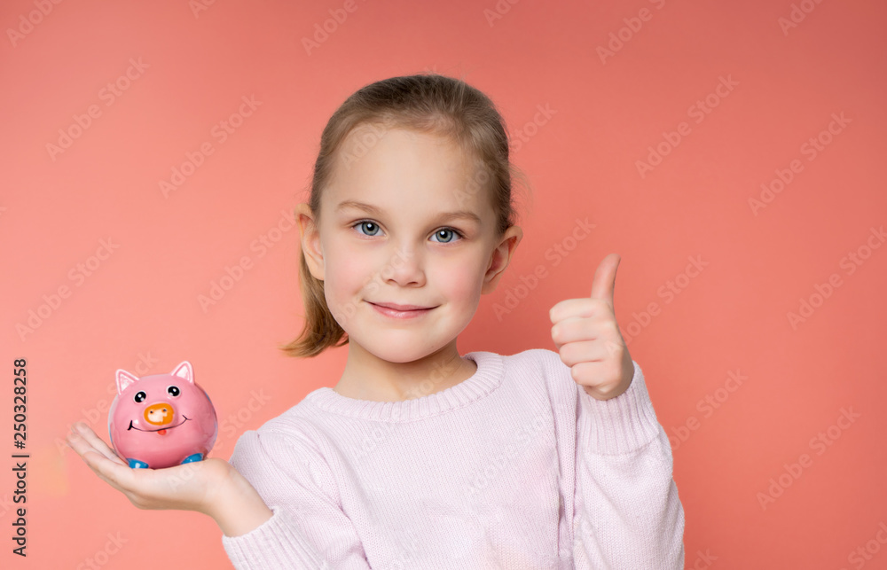 Fototapety, obrazy: girl with a piggy bank on a pink background