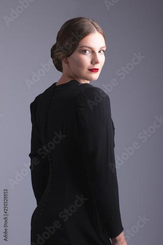 Glamorous 1930s woman in black dress Wallpaper Mural