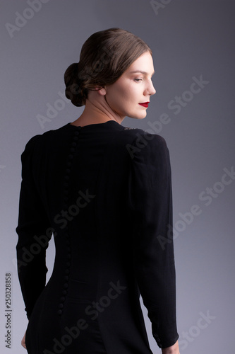 Glamorous 1930s woman in black dress Canvas Print