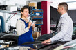 Female mechanic discussing with male client