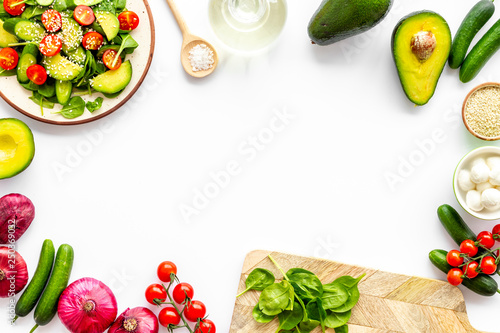 Foto op Canvas Kruidenierswinkel Preparing fresh salad. Vegetables, greens, spices on white background top view copy space frame