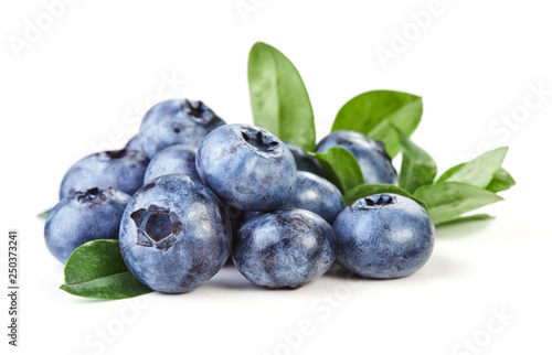 blueberries with leaves isolated on white background - 250373241