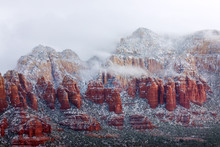 Red Rocks Covered With Snow In...