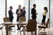 Diverse multi ethnic employees standing separately talking at work break