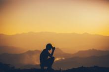 Man Sitting Praying And Worshi...
