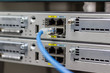 Network switch in rack, network cables connect SFP module port in the Datacenter room, concept Communication technology