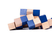Complex Mind Challenging Puzzle, Blue Wooden Cubes Toy Isolated On White Background