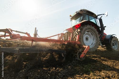 Fotografía Plowing of stubble field