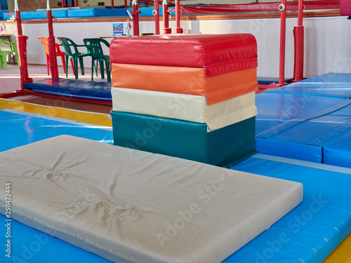 hall for gymnastics at school. multi-colored mats. doing sports. sports equipment. sport competitions