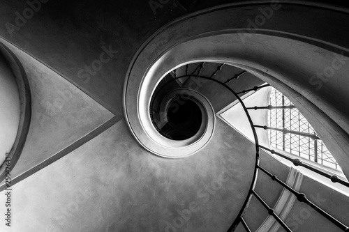 Old spiral staircase. Bottom view. Black and white.