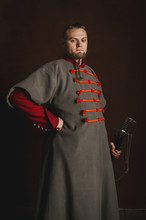 Portrait Of A Man In A Medieval Costume On A Dark Background. Clothes Of The Polish Gentry.