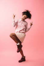 Beautiful Young African Woman Posing Isolated Over Pink Wall Background Screaming.